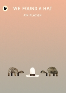 Cover of We Found A Hat. a pink to grey graded background. At the bottom are two turtles, standign either side of a tall white hat with a black band around it.