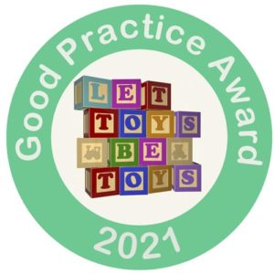 Let Toys Be Toys Good Preactice Award Sticker 2021. A green circle with the words, and inside the circle is a white background with a stack of wooden blocks spelling out Let Toys Be Toys